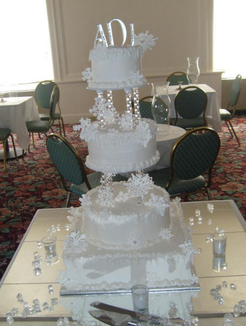 Beautiful intricate snowflakes adorn the entire cake for a beautiful winter