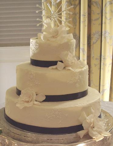 It is a small simple three tier wedding cake but it 39s simplicity stops