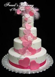 pink hearts valentines day wedding cake with feathers